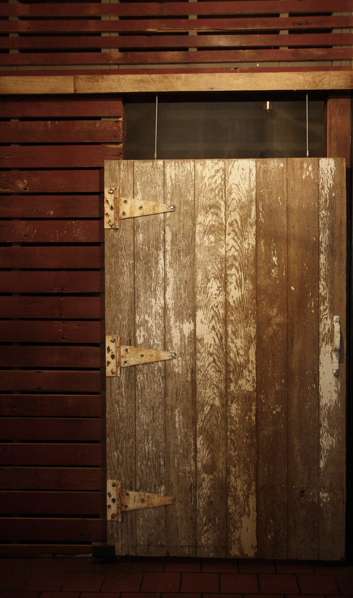 An original corral door encloses the private eating space.