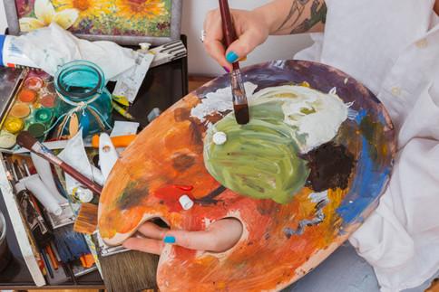 painter-mixing-colors-palette_23-2148185