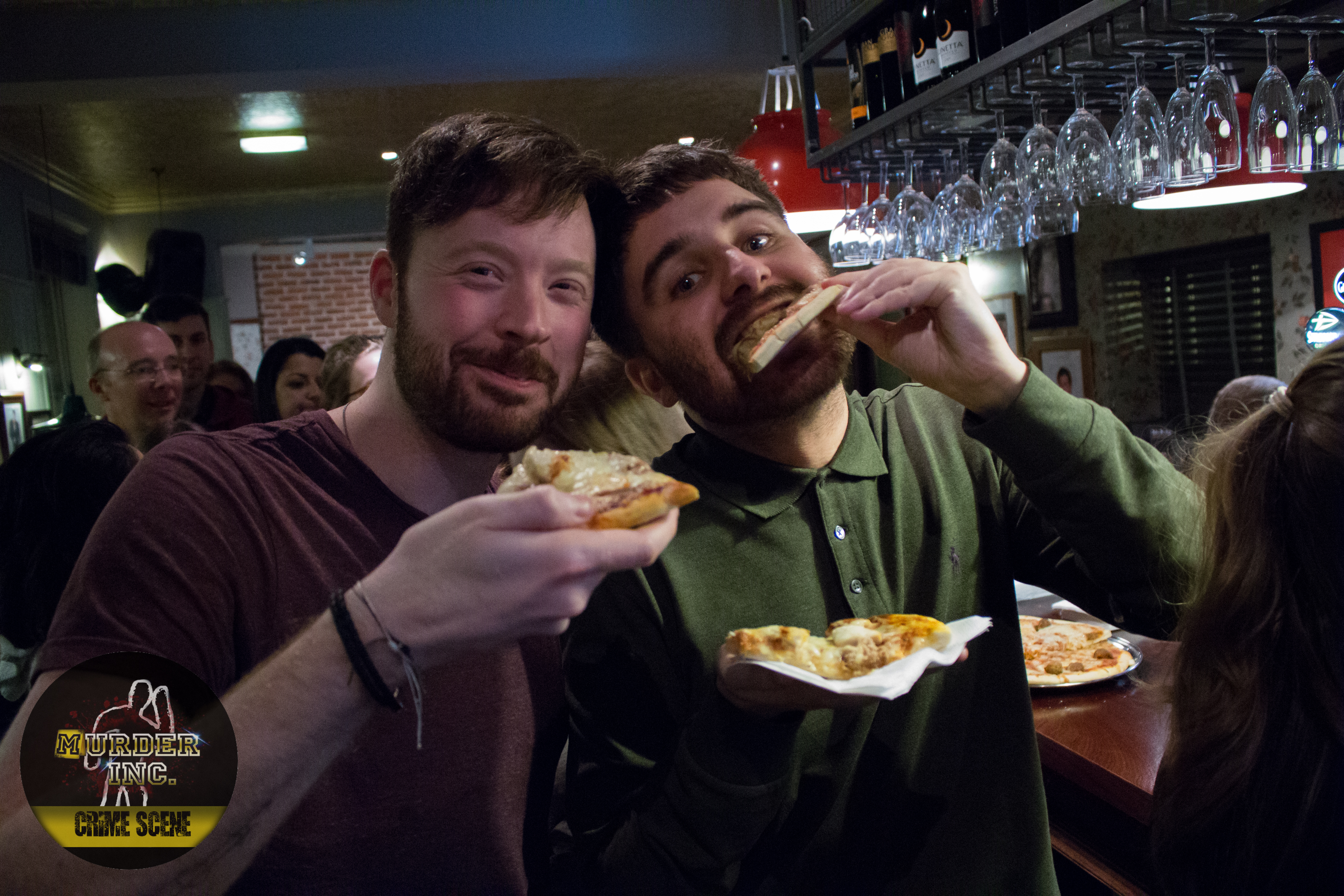 Two audience members enjoying pizza