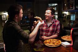 audience members eating pizza
