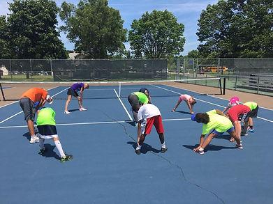 Tennis camp stretching