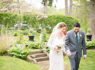 wedding couple in walking in the garden at the Copper Beech Inn