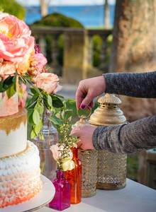CT wedding planner of Brehant Creations Events putting the finishing touches on a cake table display