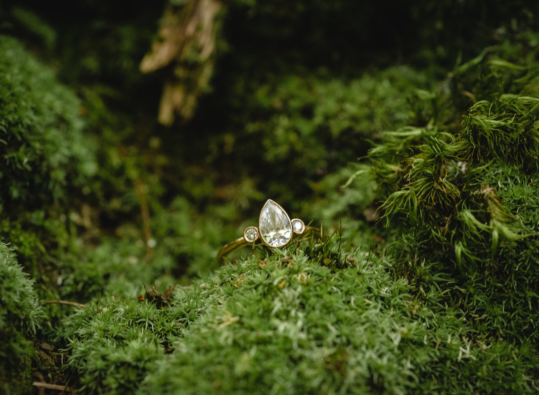 pear-cut engagement ring surrounded by moss