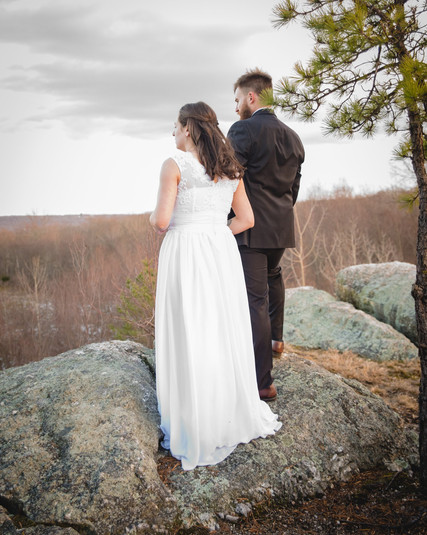 New England elopement - couple standing on rock ledge