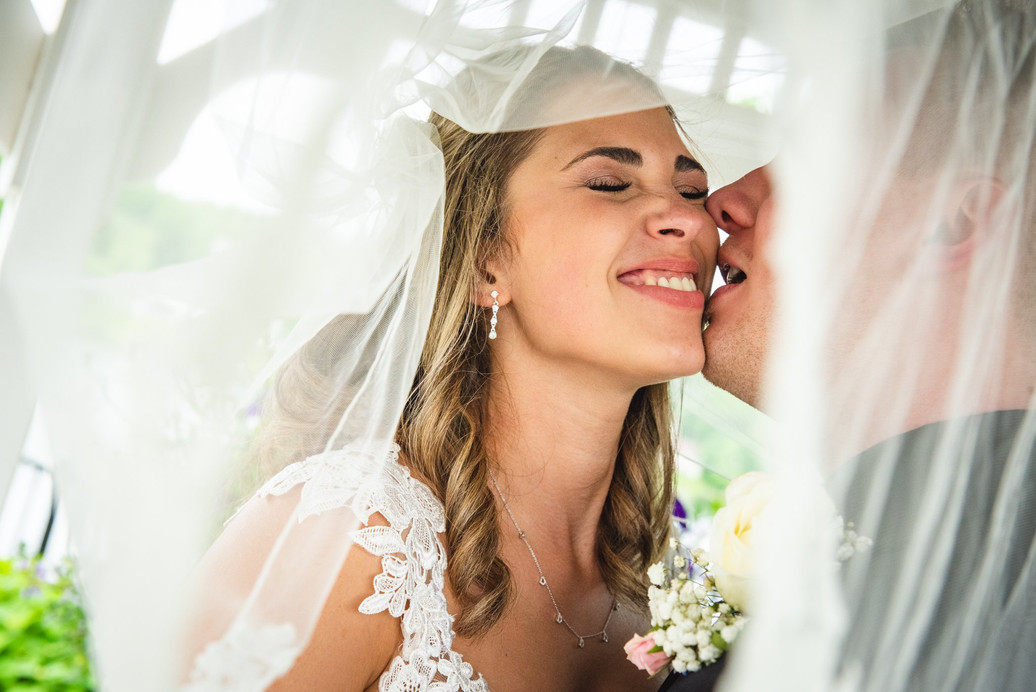 Bride and Groom laughing together under the veil at Anthony's Lake Club Catering, Danbury CT