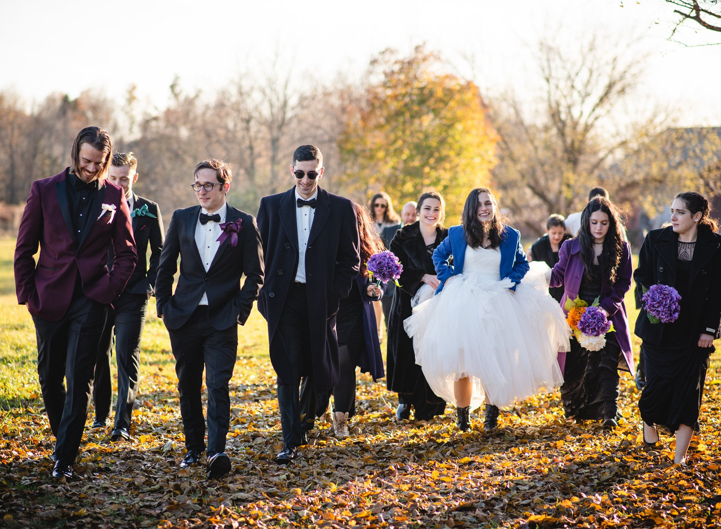 wedding party walking in a field - ct wedding photography