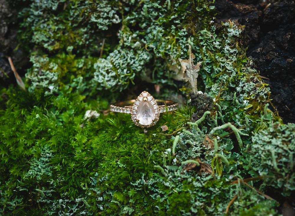 moissonite engagement ring in moss