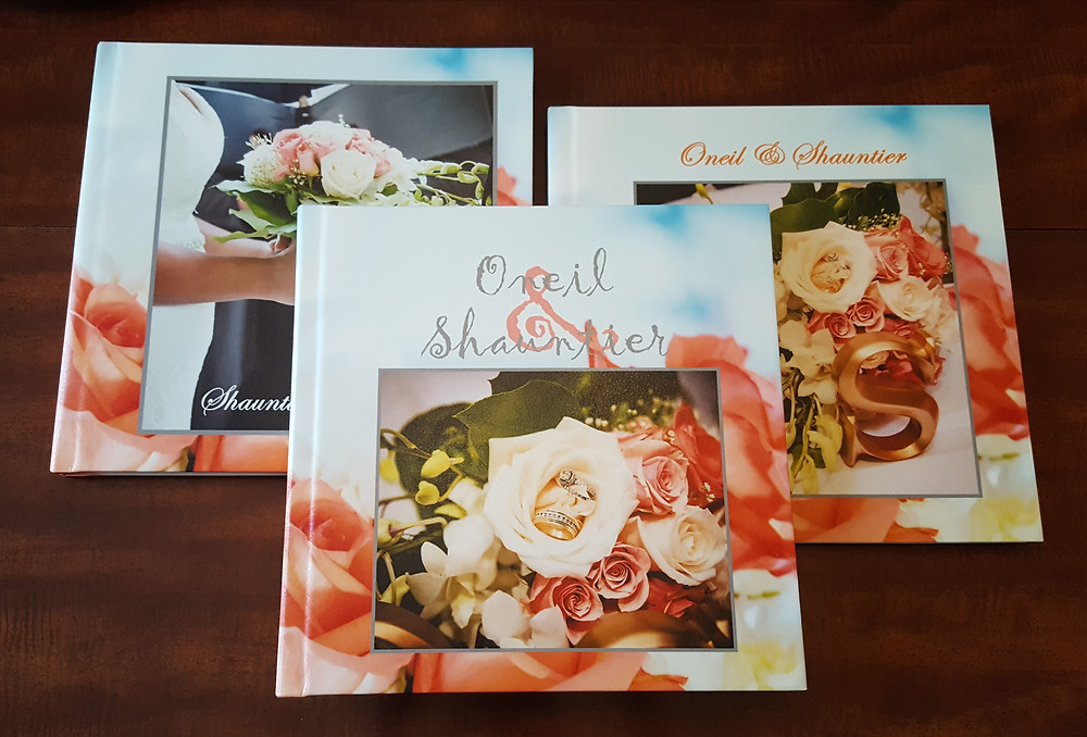 A couple's wedding album with two parent gift copies