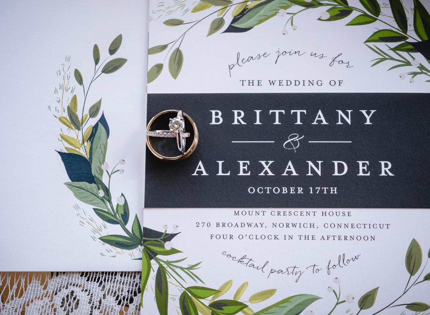 wedding rings on invitation suite
