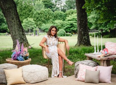 bride relaxing in backyard wedding lounge area