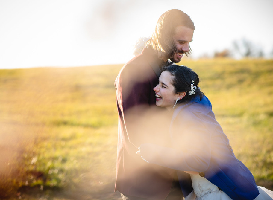 wedding couple hugging and laughing