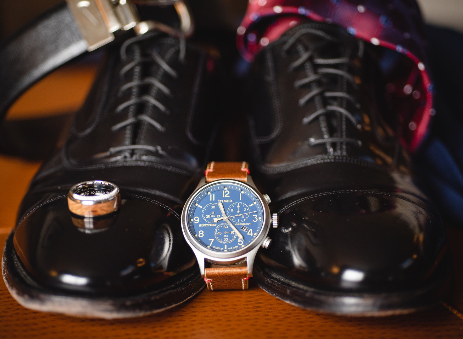 groom's details wedding photo - shoes, watch and wedding rings