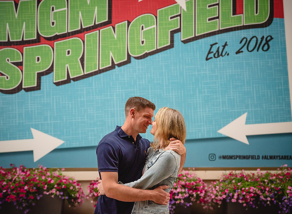 couple in front of the MGM Springfield postcard mural