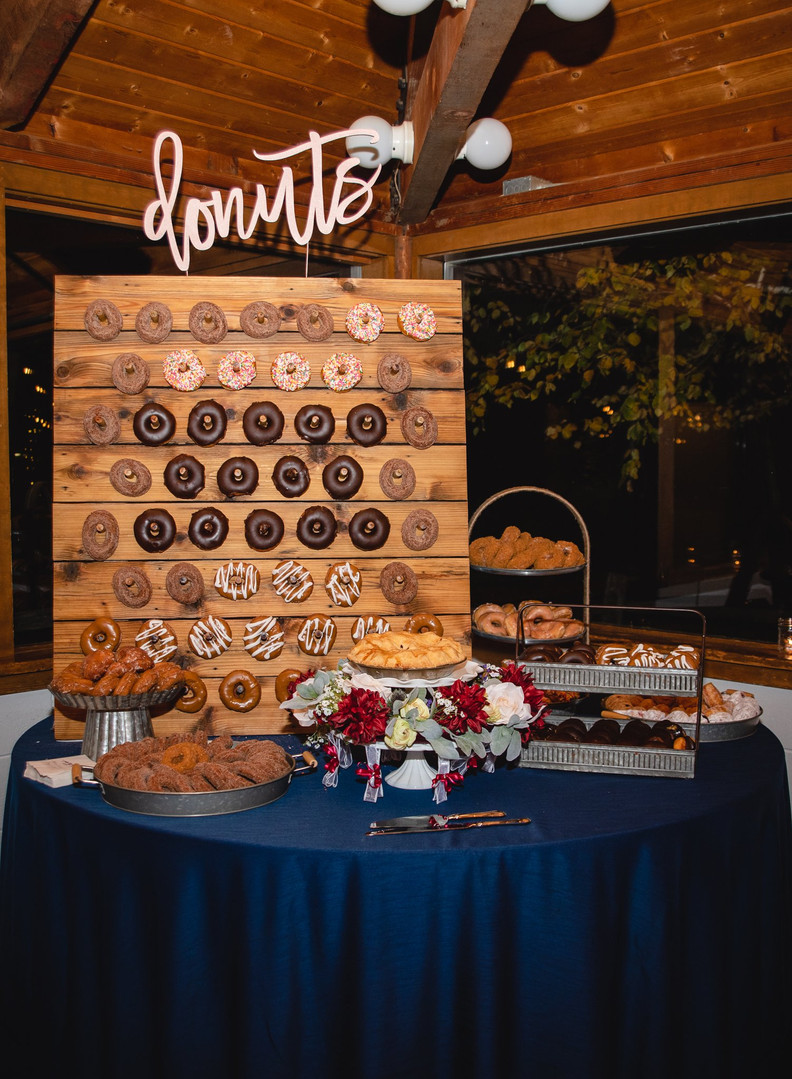 wedding dessert bar with handcrafted donut wall and homemade pie