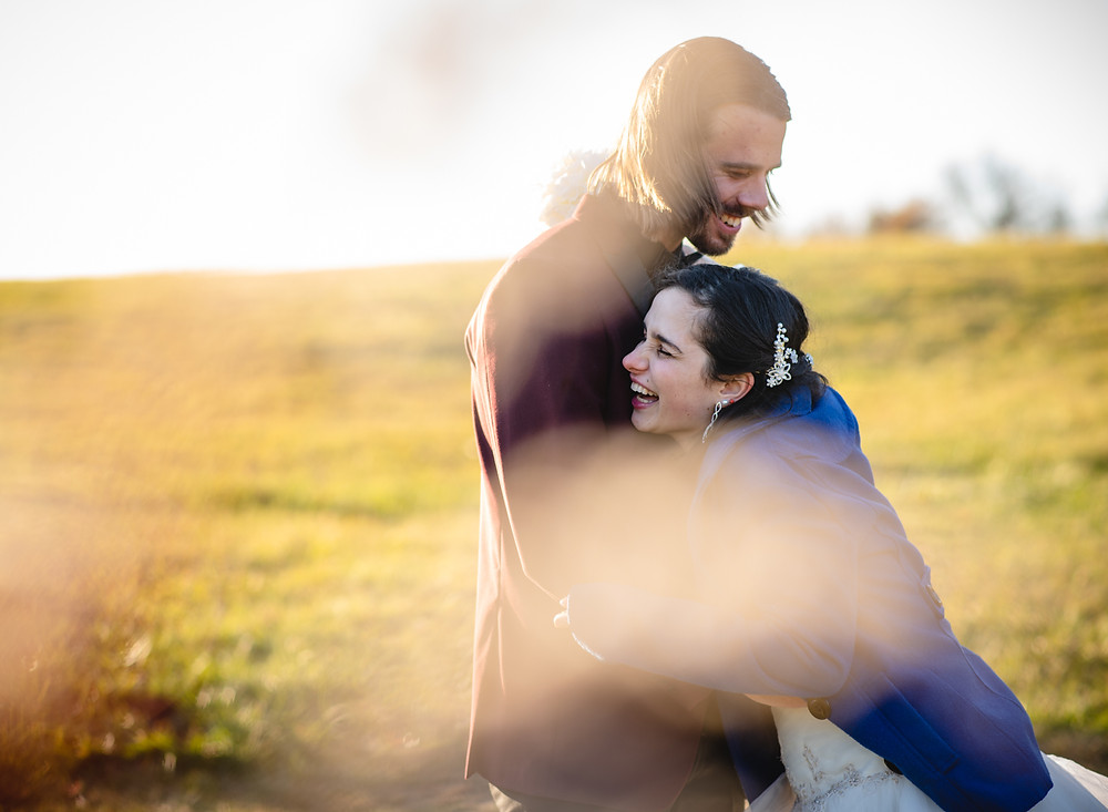 wedding couple laughing - how to have a small wedding with a big family