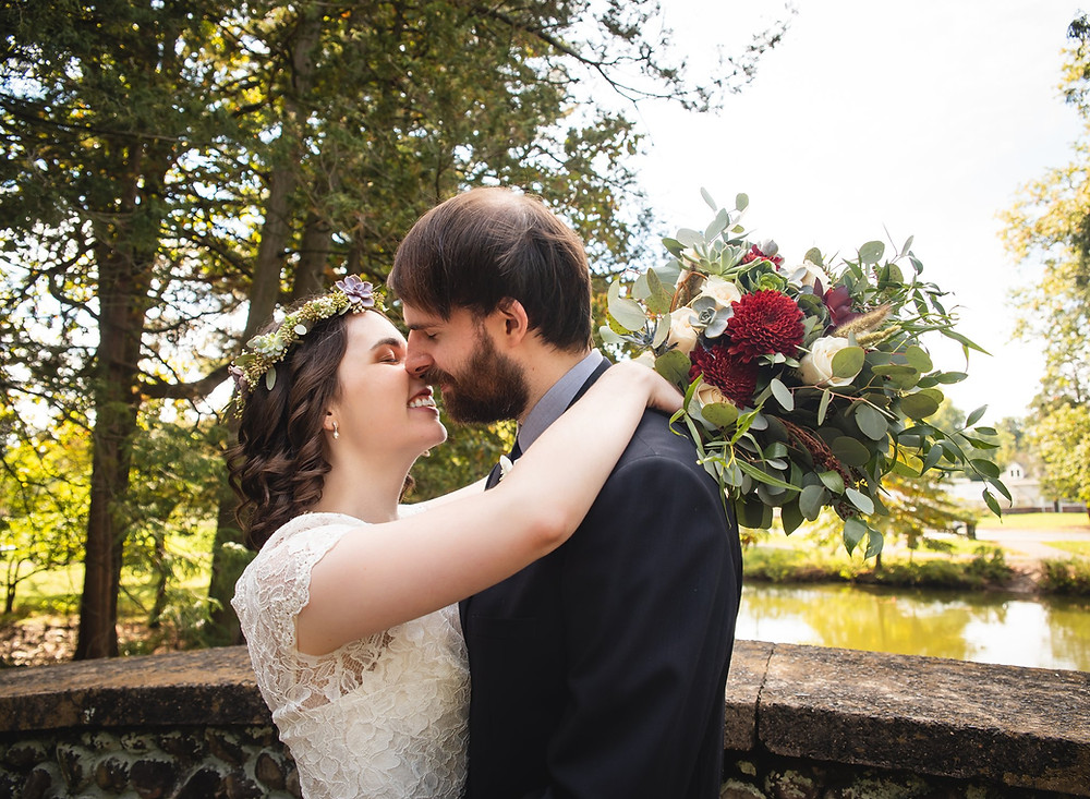 Couple kissing at the Pond House Cafe wedding