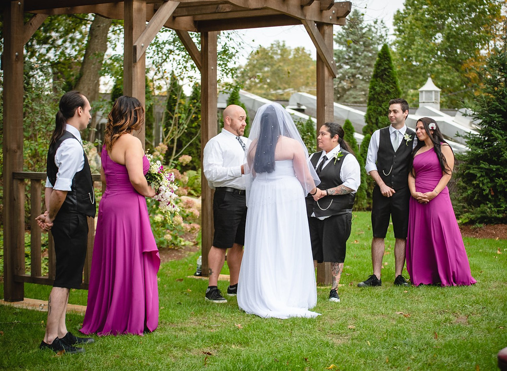 Same sex wedding with two women in a garden at THC - The Hops Company in Derby, Connecticut