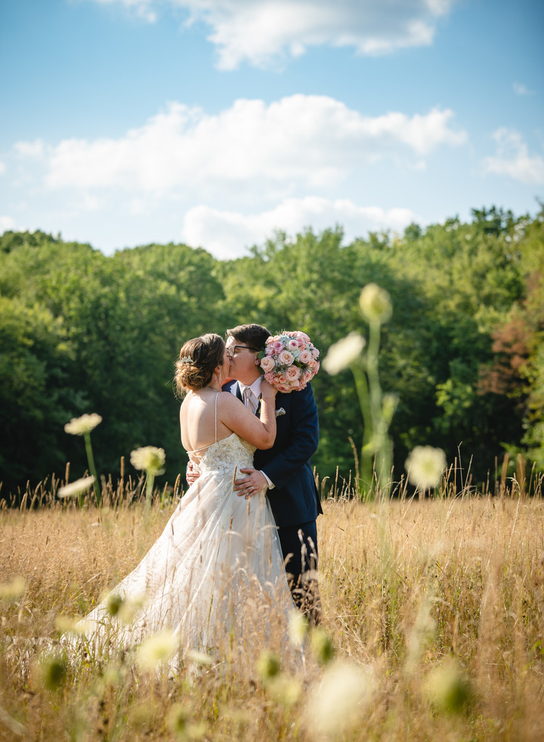 wedding couple in field by New England elopement photographer