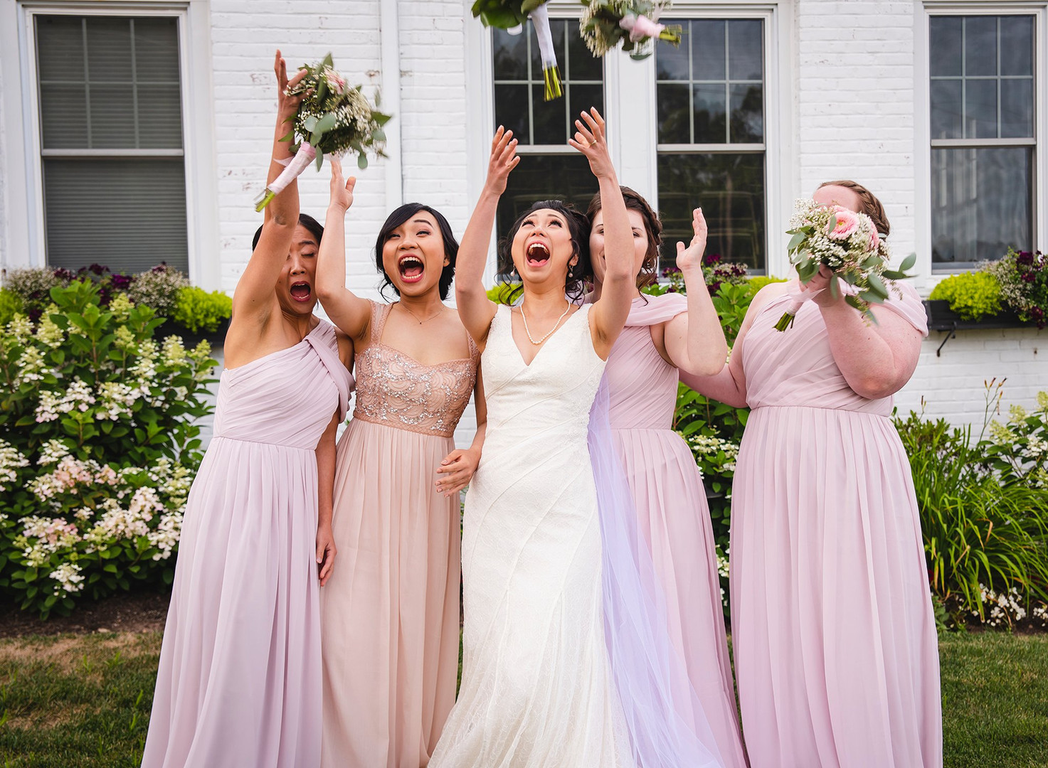 Bride and Bridesmaids toss bouquets at Glastonbury Hills Country Club CT