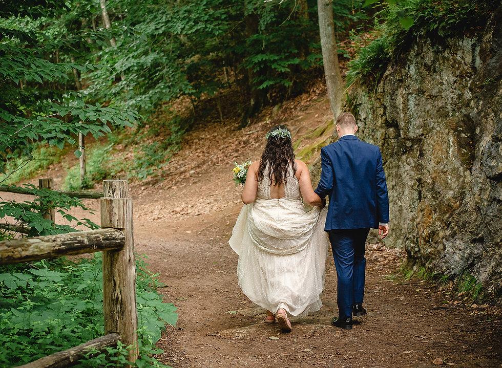 intimate wedding photography - couple walking in woods
