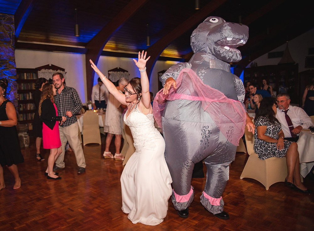 fun reception photo of a bride dancing with her father in a blow up hippo ballerina costume - Connecticut wedding photography