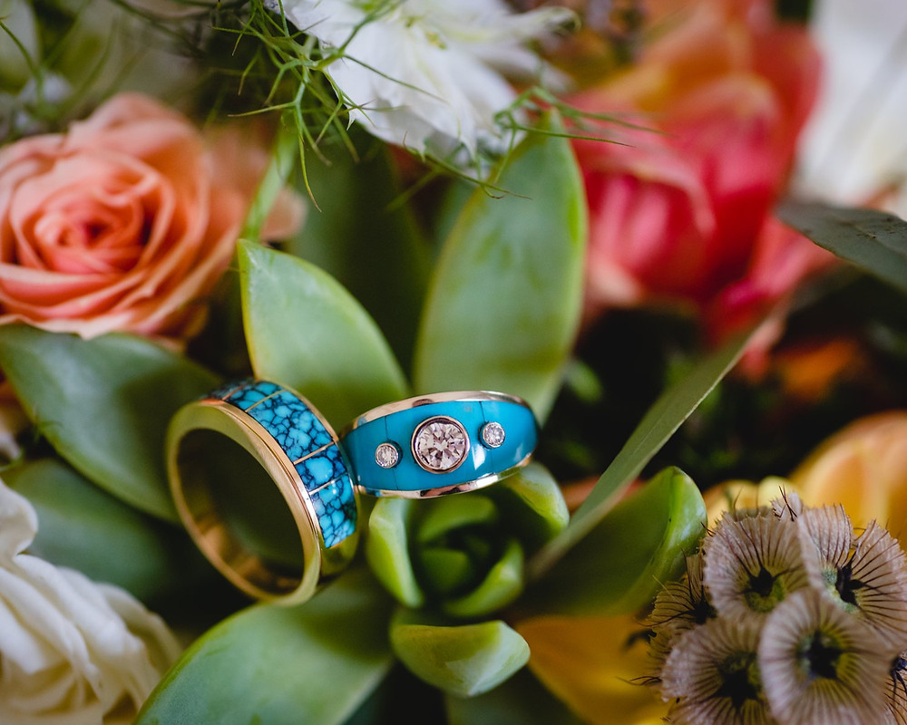 turquoise wedding rings inside a southwest-inspired wedding bouquet