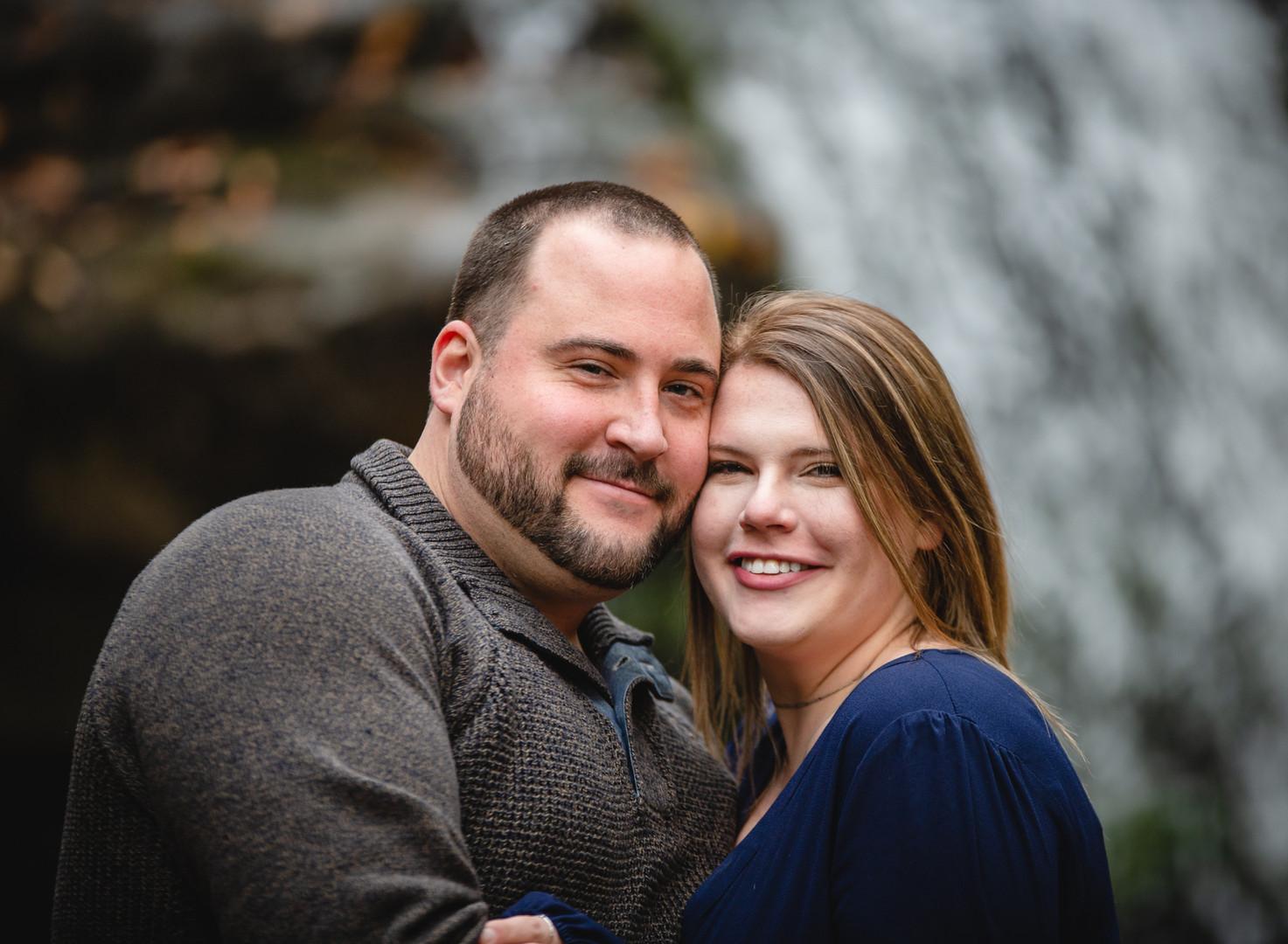 engagement portrait of couple hugging