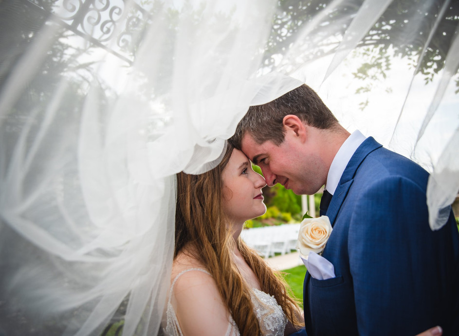 bride and groom under the veil at Aria in Prospect CT
