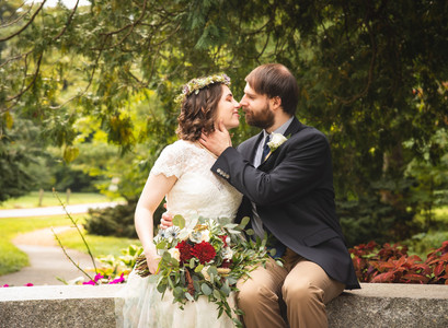 bride and groom kissing at their Pond House Cafe wedding