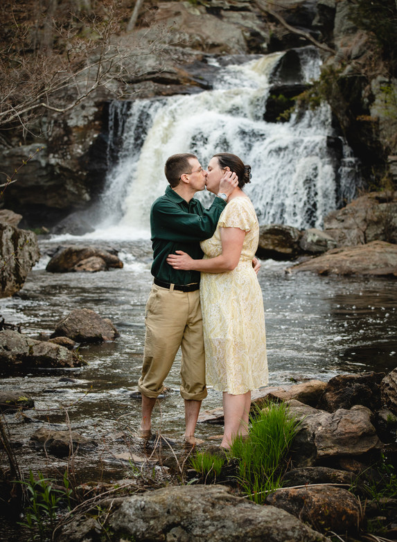 couple kissing in the river for engagement photos in CT