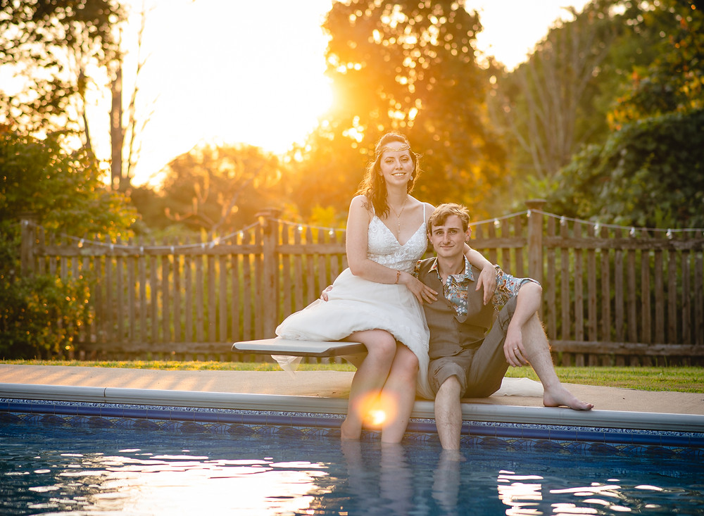 elopement couple by the pool at sunset