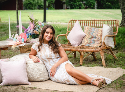 bride relaxing in outdoor lounge at a backyard wedding