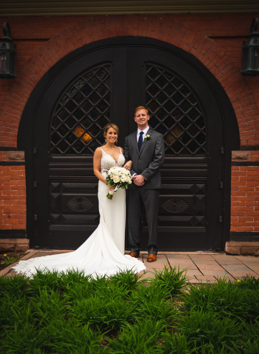 wedding photo in front of old fashioned doors