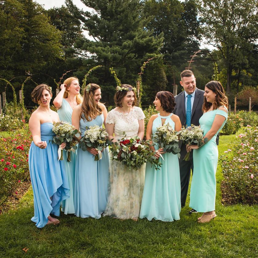 Bride and bridesmaids having fun at Elizabeth Park Weddingin Hartford CT