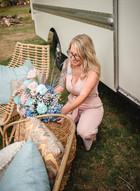CT wedding planner Sarah Brehant adjusting floral arrangements