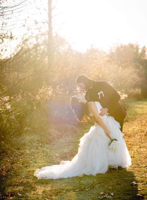 bride and groom kissing in golden hour sunlight - wedding photography ct