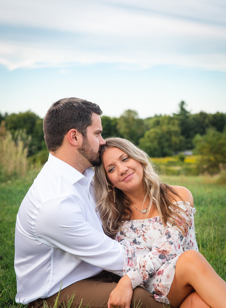 summer engagement picture at a vineyard and farm