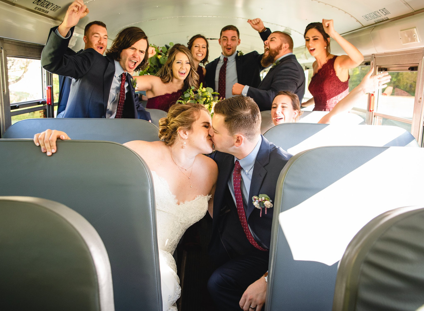 wedding party in school bus by New England wedding photographer