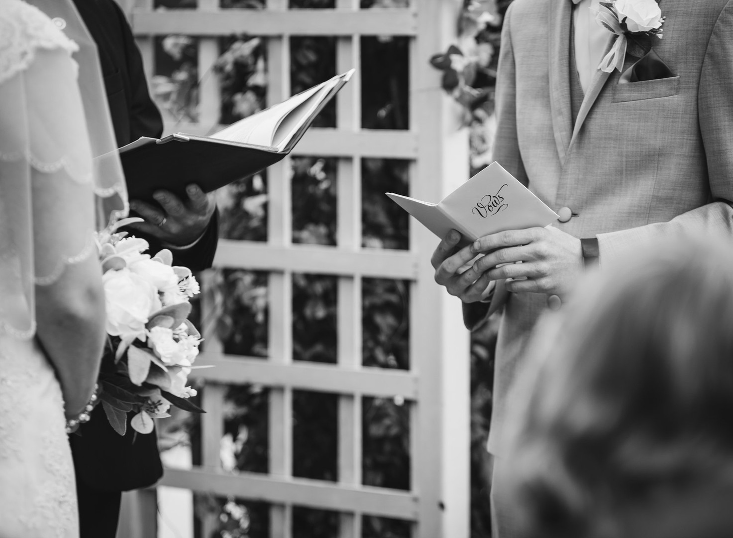 black and white close up photo of wedding vow reading