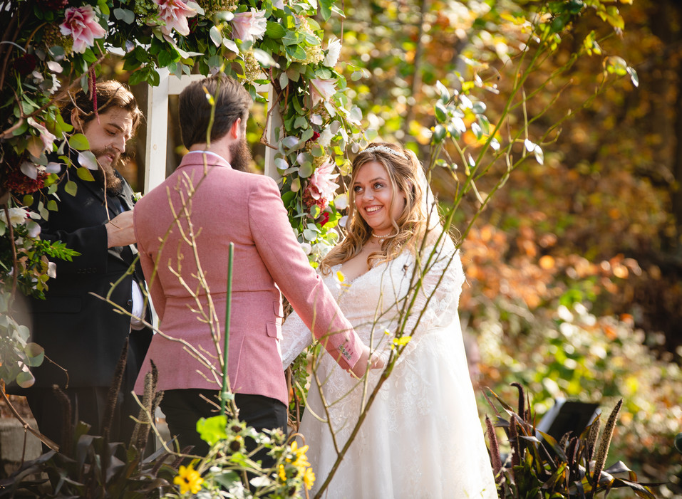 couple exchanging vows at backyard wedding ceremony