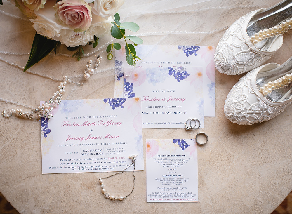 flat lay picture of the bride's wedding details