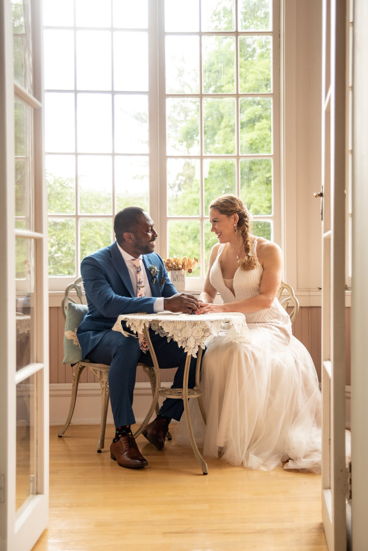 bride and groom sitting together - ct wedding photos
