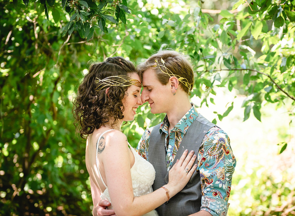 bride and groom embracing at their intimate backyard wedding