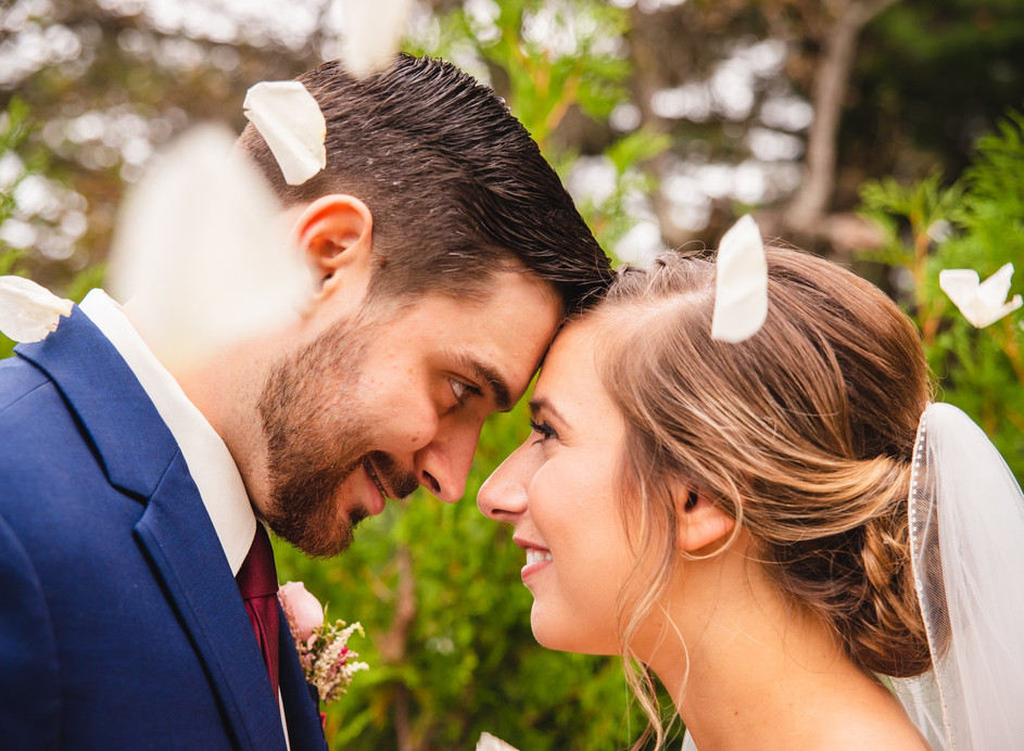 close up photo of bride and groom with rose petals falling - connecticut wedding photography