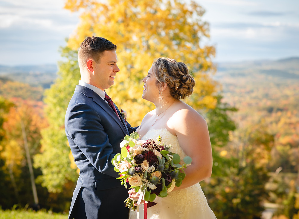 elope in Connecticut - couple kissing in field