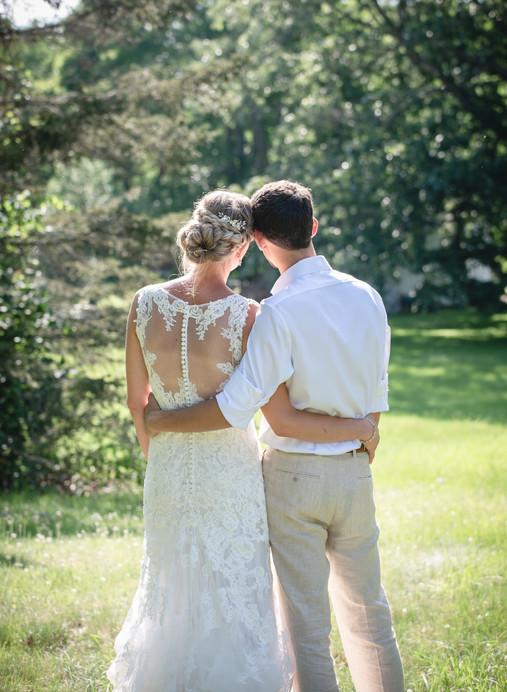 New England backyard wedding couple hugging