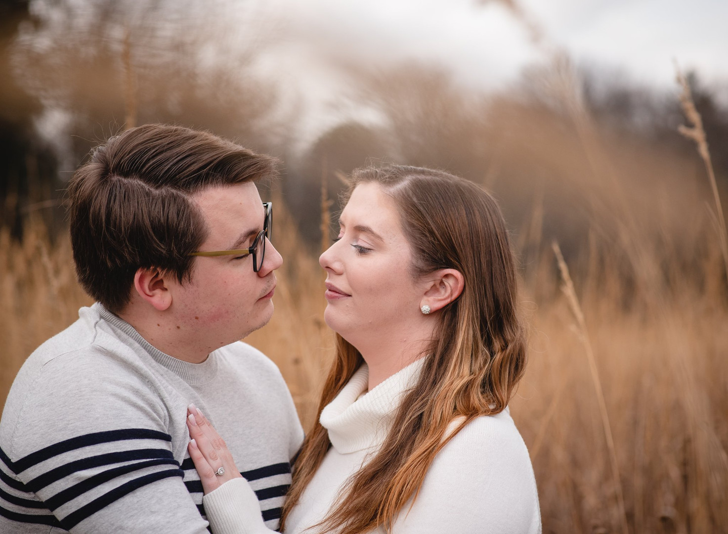 couple in a meadow at Valley Falls Park in Vernon CT