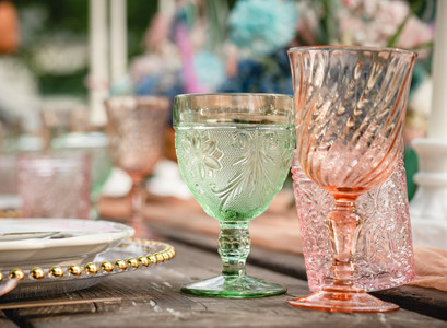 mismatched glassware inspiration for a backyard wedding