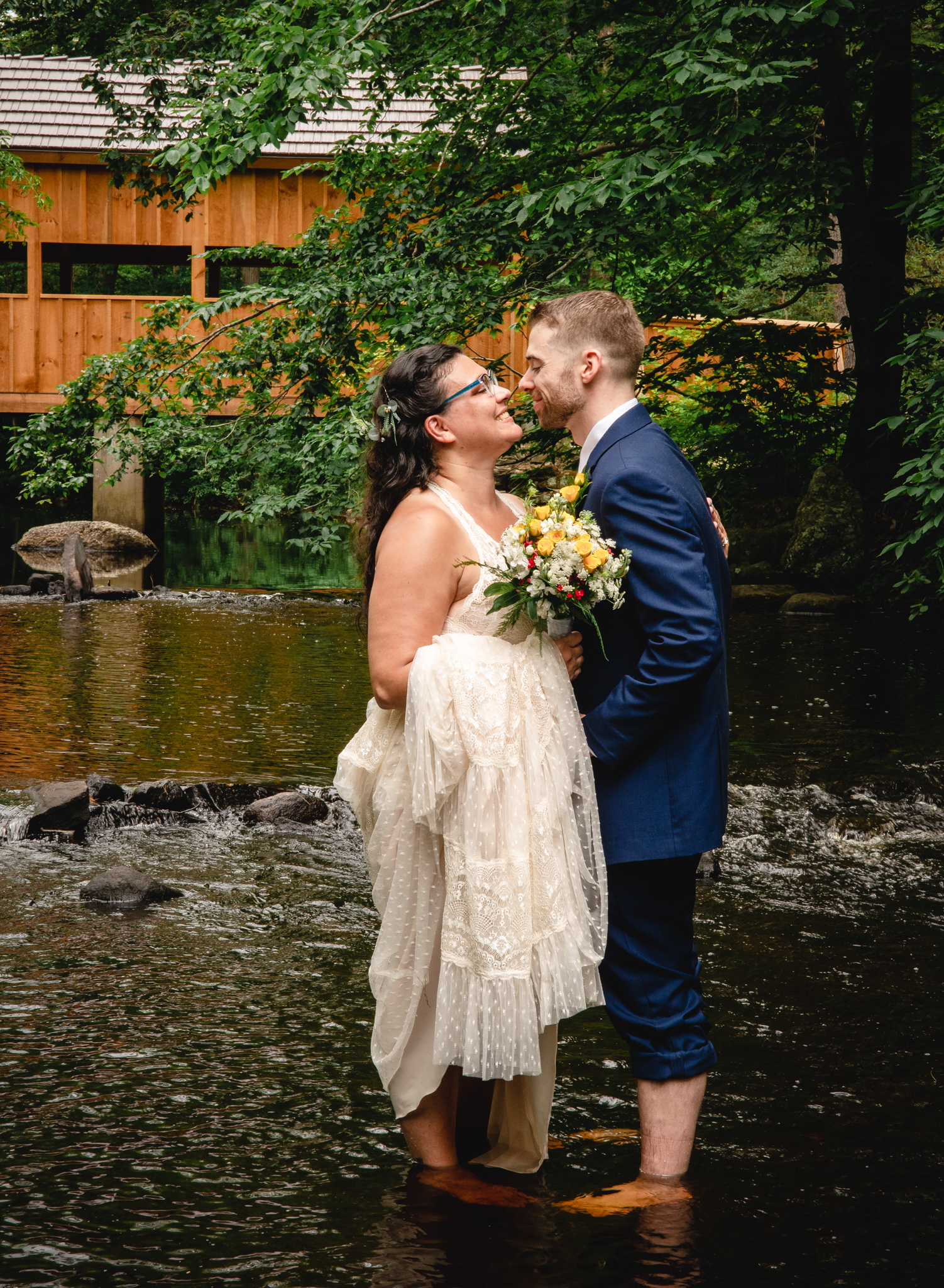 elopement couple standing in a stream